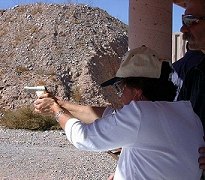 Marcia firing a the Taurus pocket pistol PT22